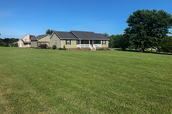 Home in Bowling Green, KY receiving lawn mowing services.